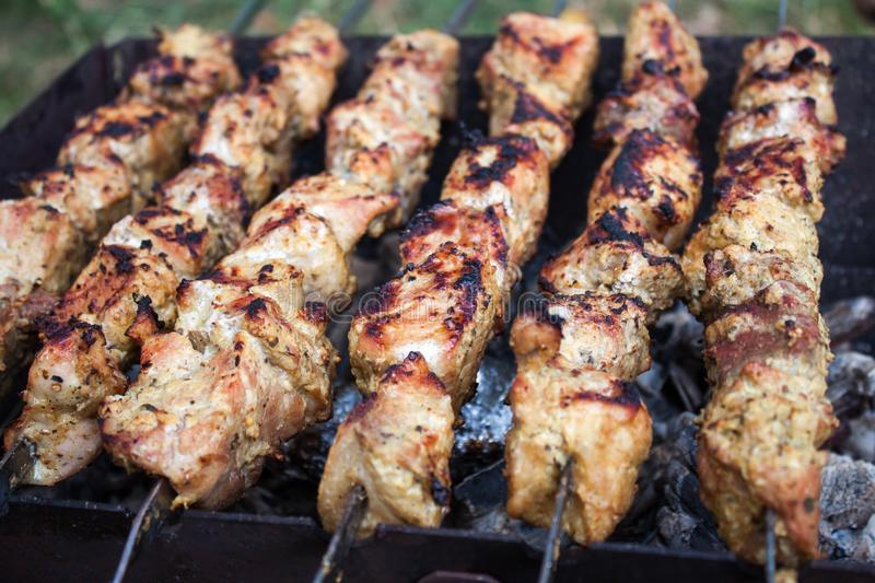Skewers grilling. On a barbecue stock photos
