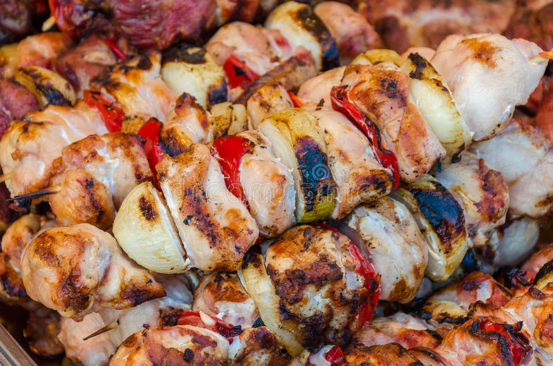 Skewers on wooden stick with tasty pork meat and vegetables mix stock photography