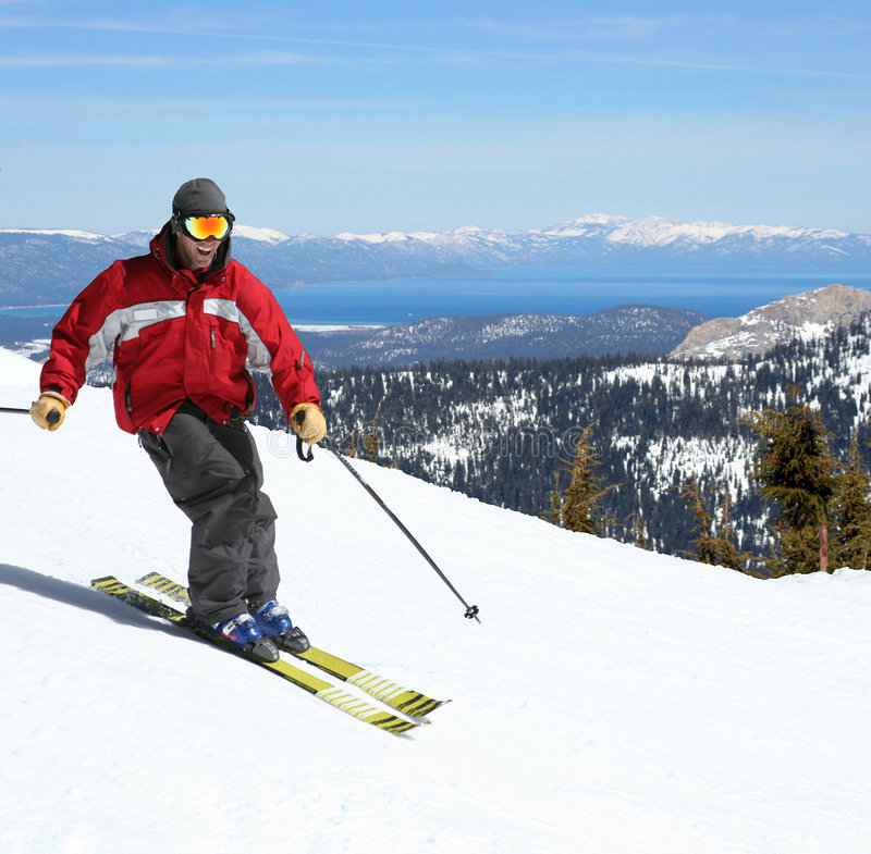 Skiër op een helling royalty-vrije stock afbeeldingen