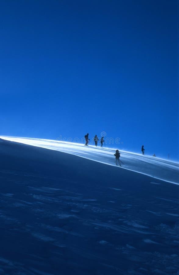 Skiërs stock foto's
