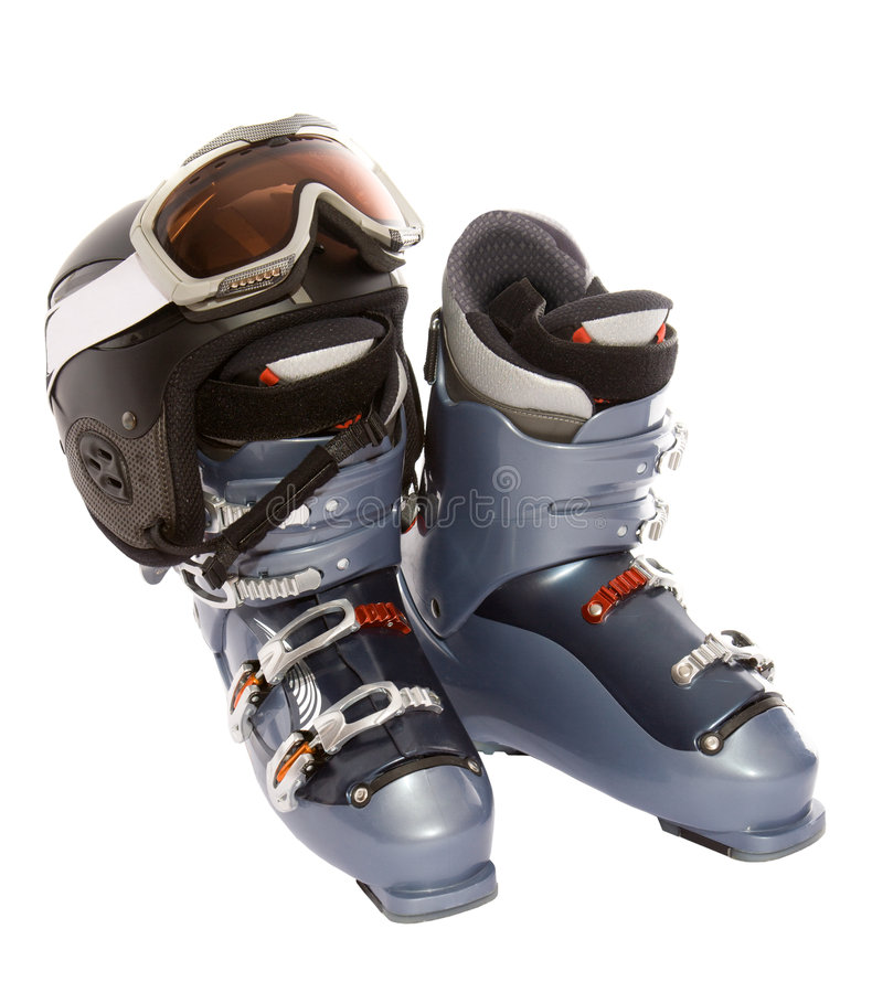 Ski boot's helmet and mask goggles royalty free stock photography