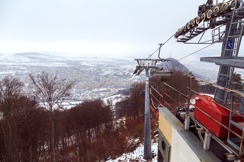 Ski cable in Piatra Neamt , Romania, arriving on top of mountain view on winter day.  stock photo
