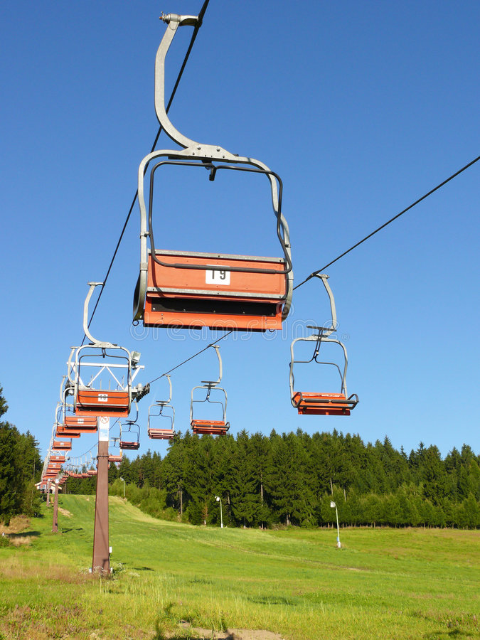 Ski chair lift. Empty ski chair lift in summer stock photography