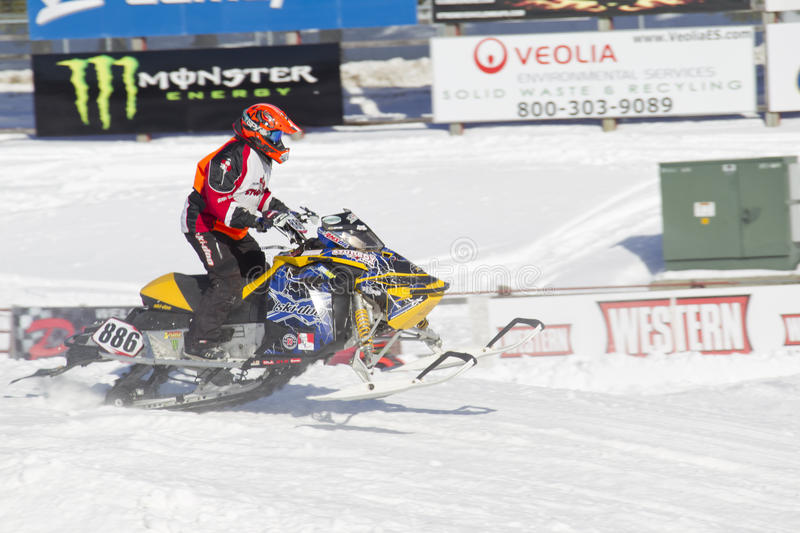 Ski-Doo Blue & Yellow Snowmobile Racing. EAGLE RIVER, WI - MARCH 2: Ski-Doo Blue & Yellow Snowmobile Racing during a race on March 2, 2013 in Eagle River royalty free stock photos