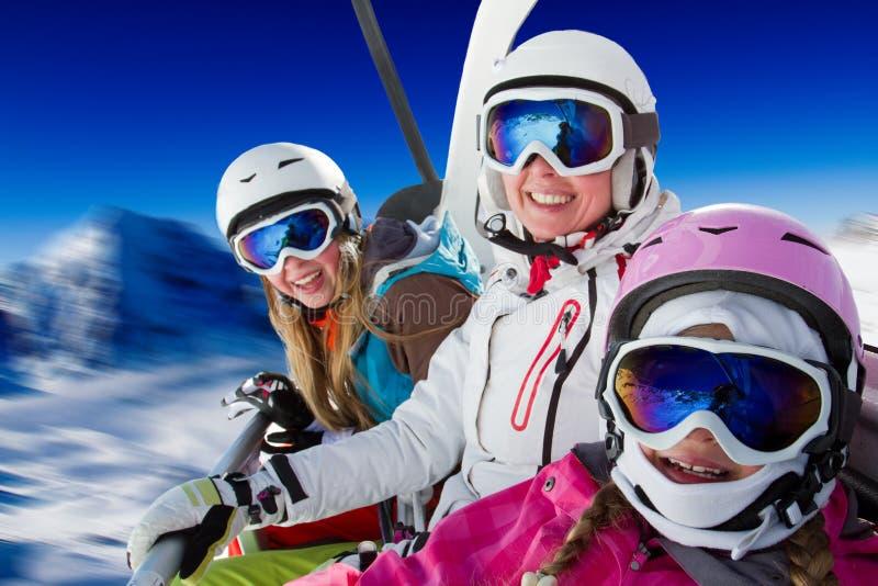 Ski family. Skiing, ski lift, winter - skiers on ski lift