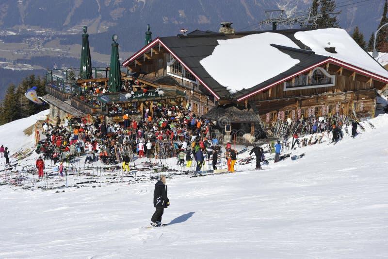 Ski Hut Full of Skiers. Mountain hut full of skiers in the ski area Planai in the Alps, Steiermark, Austria, Europe. It's part of the Ski Amade region stock image