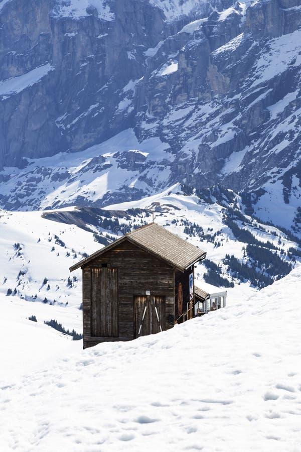 Ski hut shop center at First peak in Grindelwald , Berne Switzerland. GRINDELWALD BERNE, SWITZERLAND- APRIL 24: Ski hut shop center at First peak Jungfau, APRIL royalty free stock photo