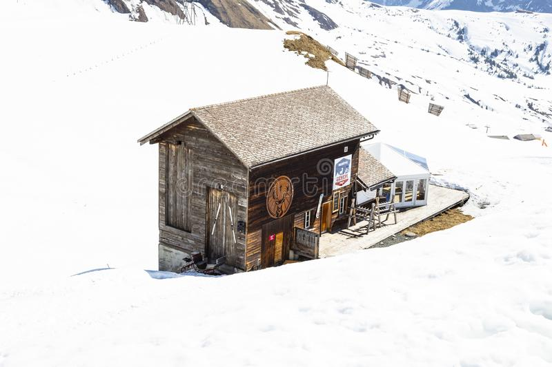 Ski hut shop center at First peak in Grindelwald , Berne Switzerland. GRINDELWALD BERNE, SWITZERLAND- APRIL 24: Ski hut shop center at First peak Jungfau, APRIL stock photography