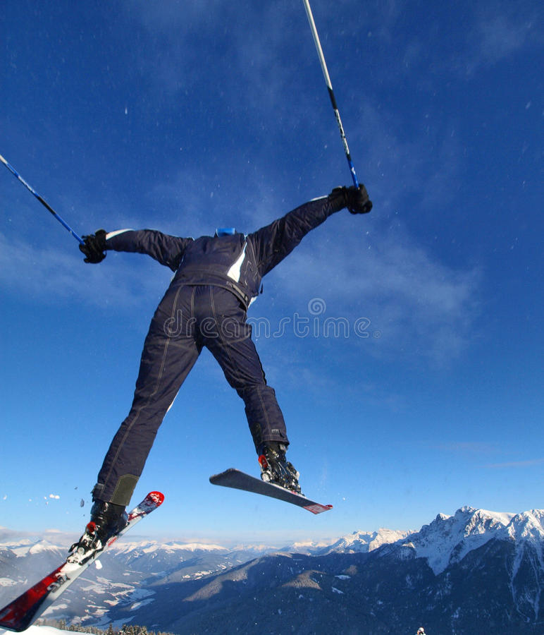 Ski jump. Free ride and jumping from top of mountain, blue sky snow and extreme jump stock photo