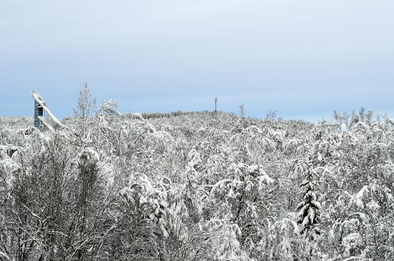 Ski jump tower in snowy forest in tromso stock photo