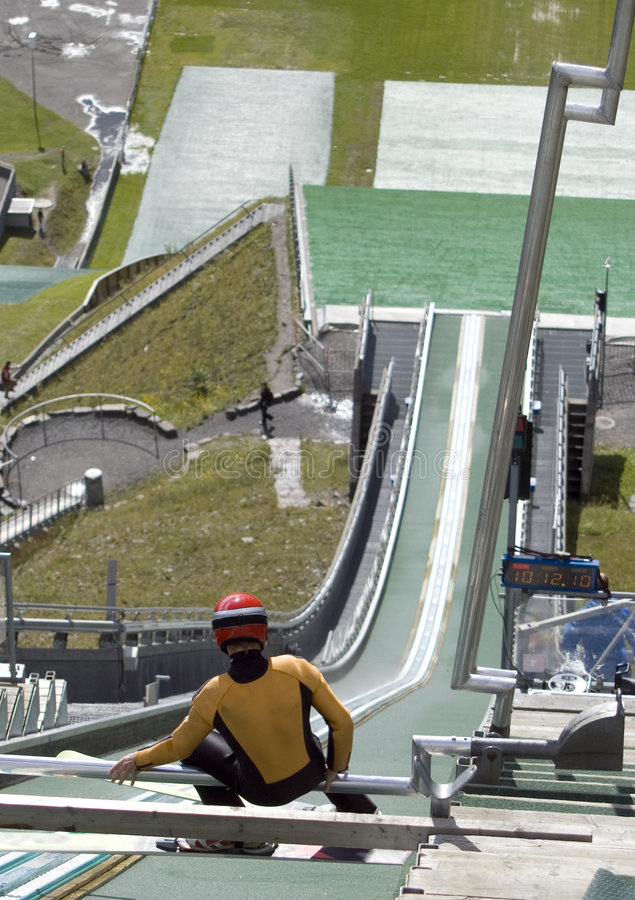 Ski jumper ready. A ski jumper preparing to jump. Summer season, the slope covered with artificial grass. Lillehammer, Norway. MORE SPORT IMAGES stock image