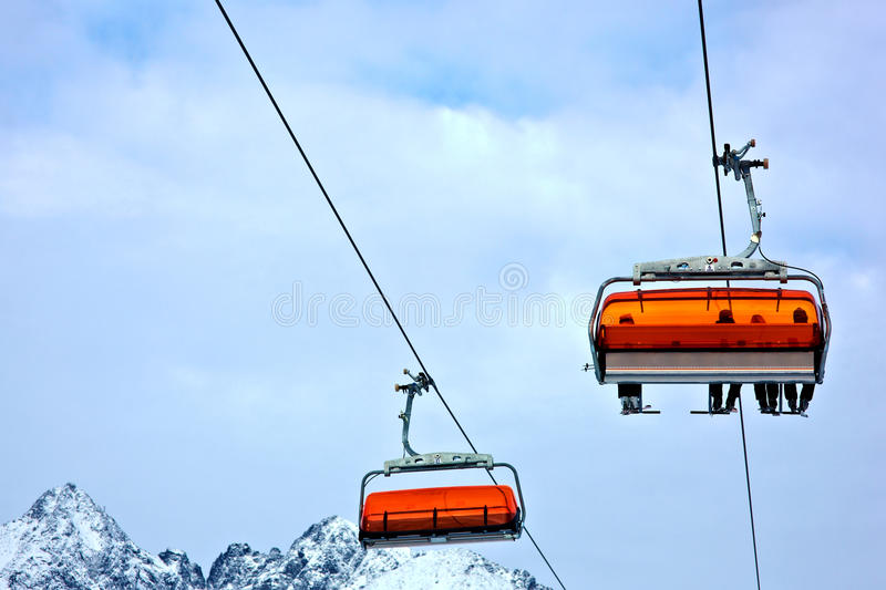 Ski lift. With people in high mountains stock photos