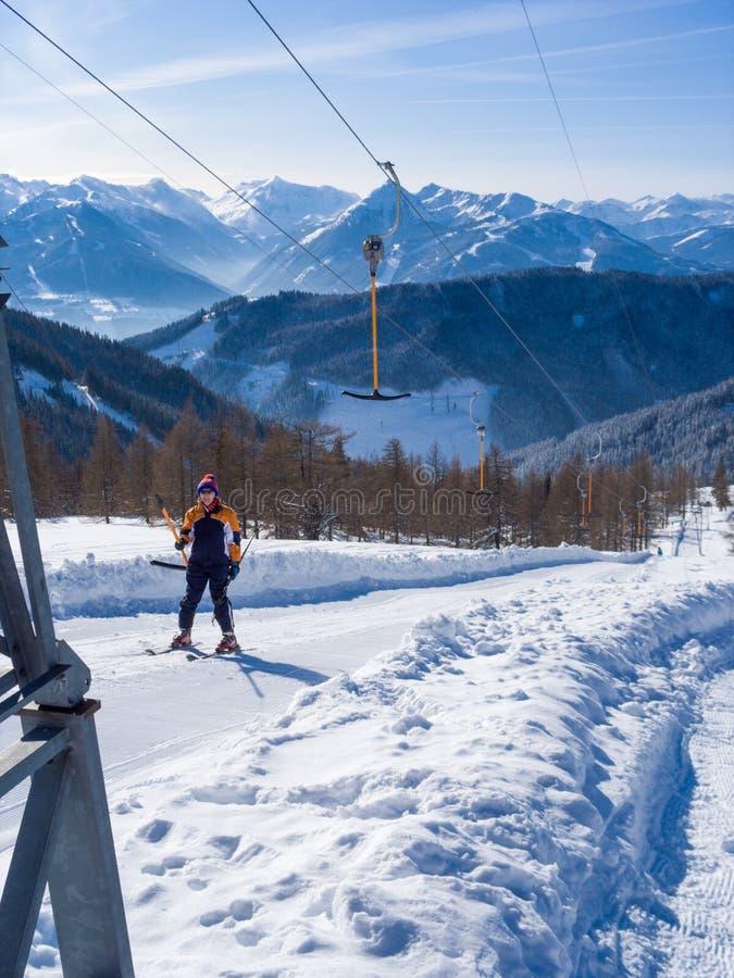 Ski lift. Skier on the ski lift royalty free stock photos