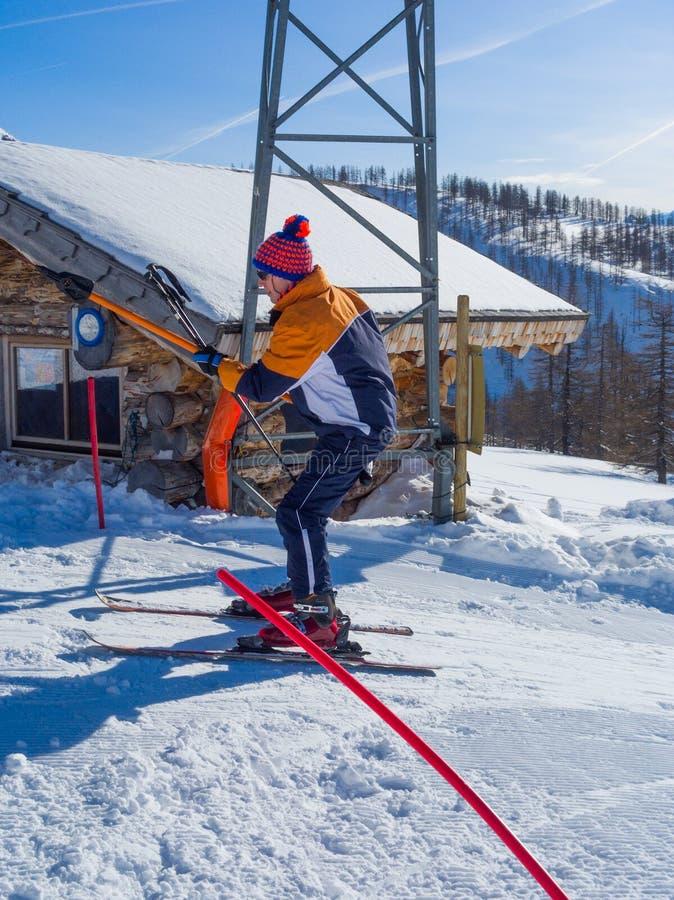 Ski lift. Skier on the ski lift royalty free stock photo