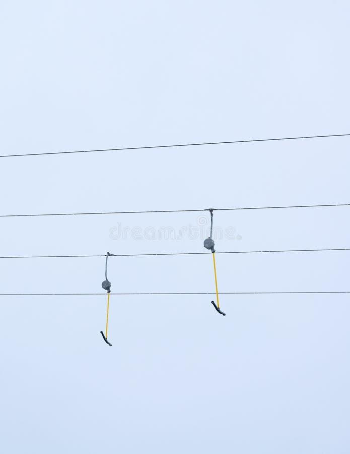 Ski lift against background sky stock photography