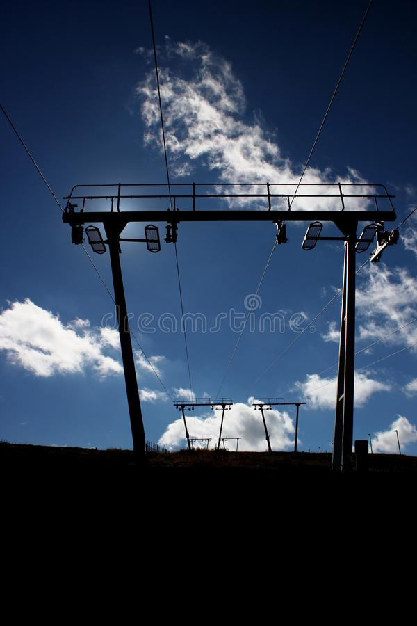 Ski Lift In Back Light imagem de stock