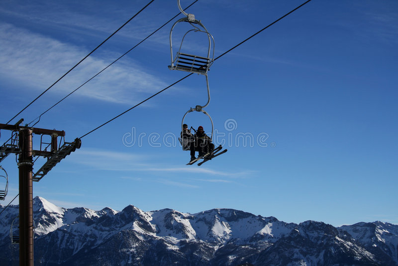 Ski-lift on a blue sky. And big mountain (France stock image