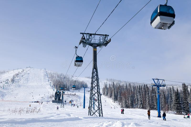 Ski lift, cable car funicular with open cabin on the background royalty free stock images