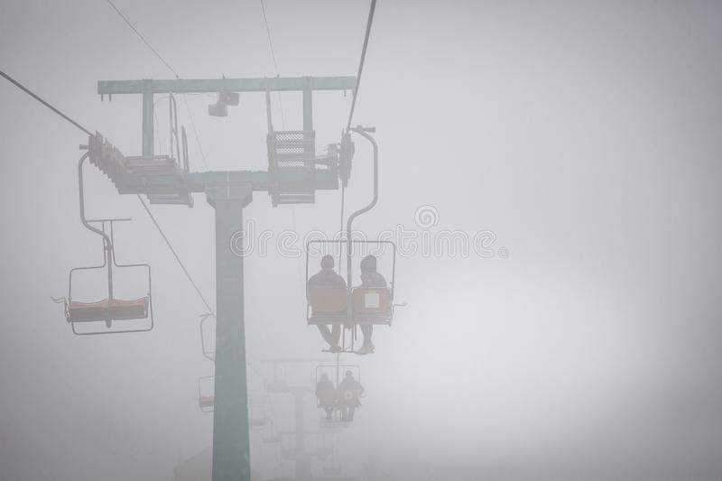 Ski lift in the Carpathians. Autumn foggy day stock image