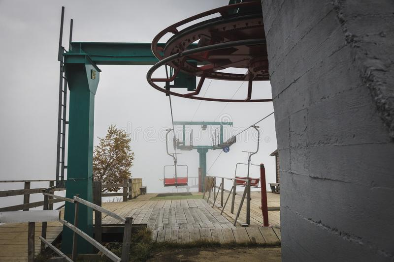 Ski lift in the Carpathians. Autumn foggy day royalty free stock images