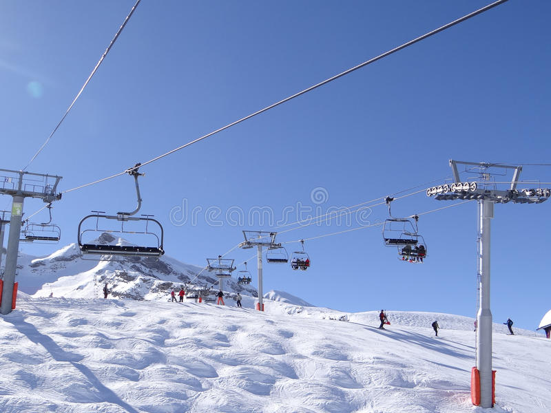 Download Ski lift carries skiers stock image. Image of snow, skiers - 31359077