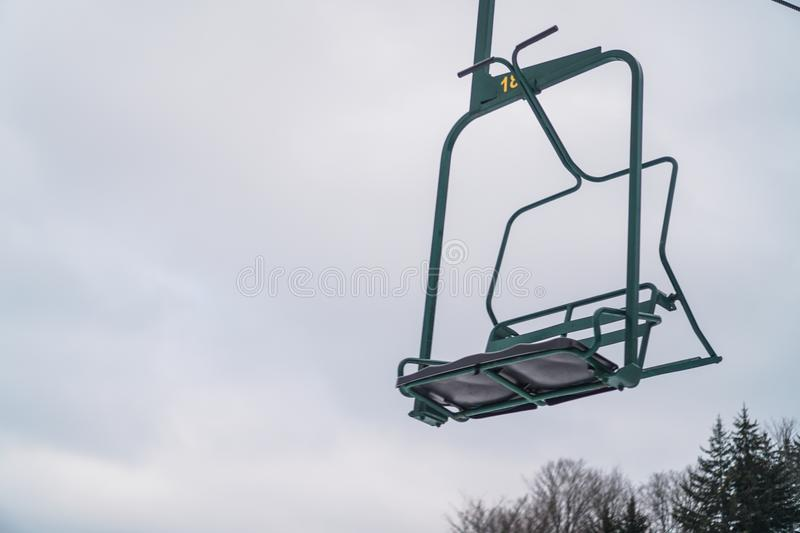 Ski lift chair. In winter that fits two people stock images