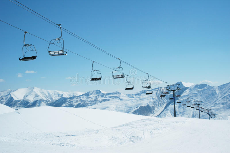 Ski lift chairs on bright day. Ski lift chairs on bright winter day stock photo