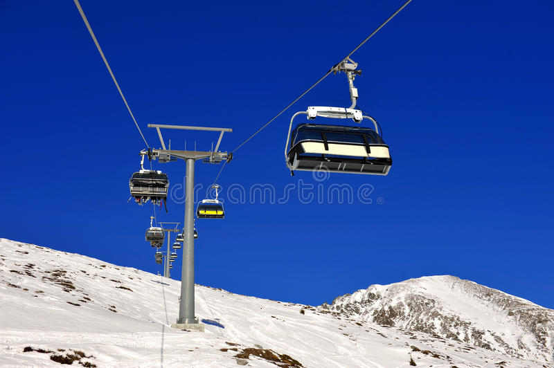 Ski lift. Chairs on bright winter day stock photos