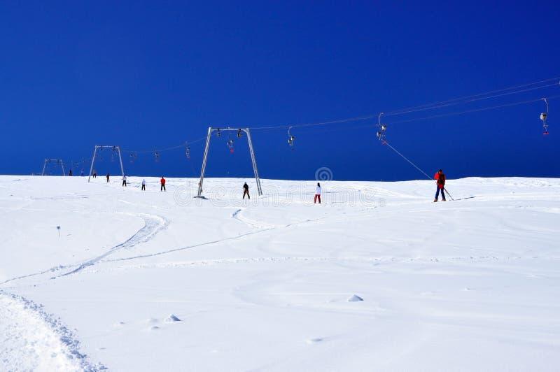 Ski lift instalation. Taking people up on the slope at Sureanu ski resort, Romania royalty free stock photography