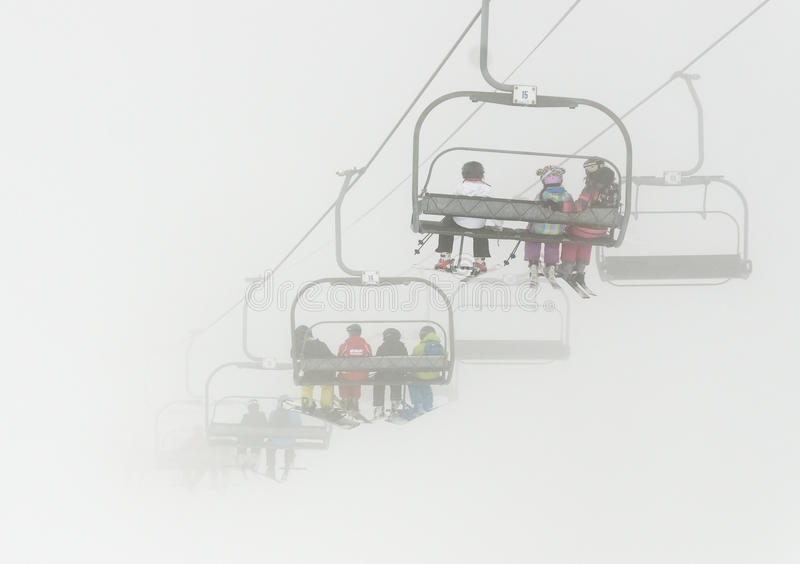 Ski lift in the mist royalty free stock image