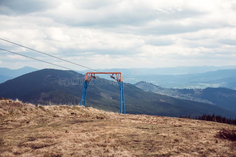 Ski lift in the mountains. Horizontal image royalty free stock photography