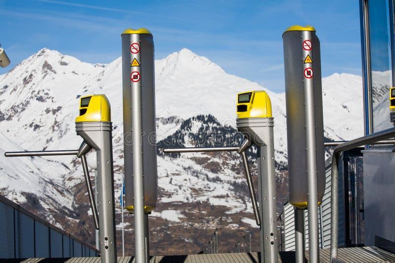 Ski lift in the mountains. Ski lift at the peaks of mountains stock photo