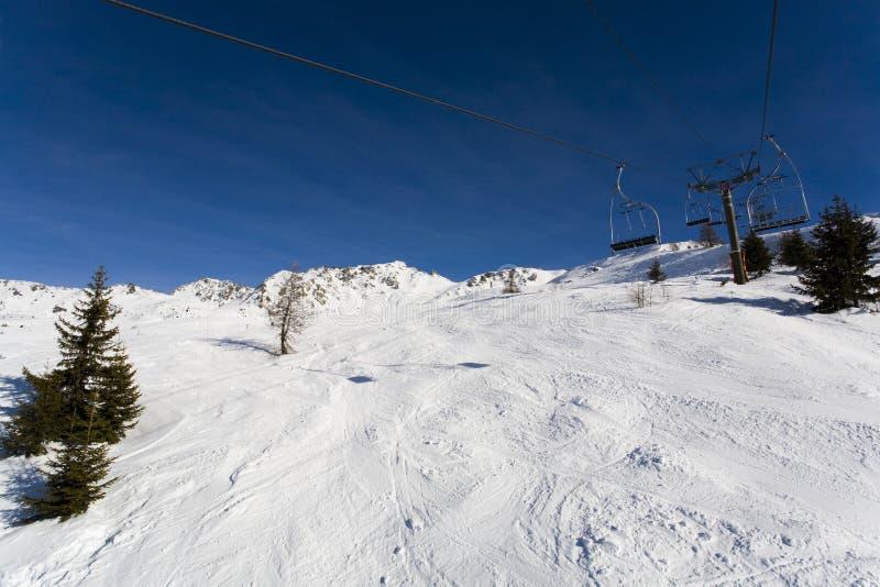 Ski lift in the mountains. Ski lift at the peaks of mountains stock photos