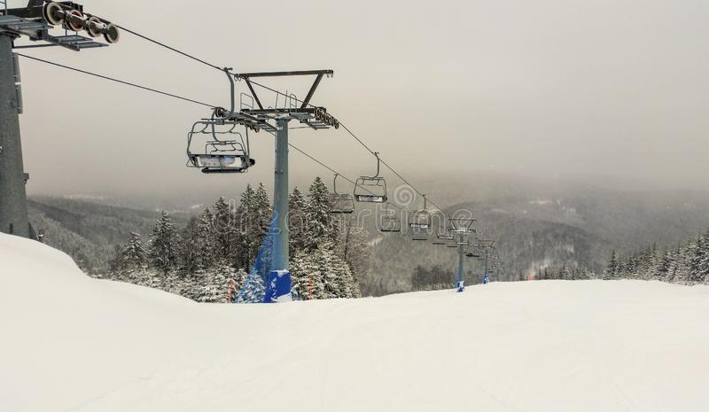 Ski lift in the mountains. Winter. Ski slope. Sport activities royalty free stock photography