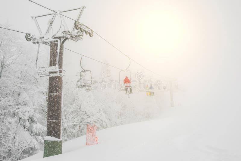 Ski lift over snow mountain in ski resort . Ski lift over snow mountain in ski resort royalty free stock images