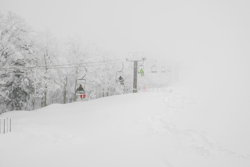 Ski lift over snow mountain in ski resort . stock images