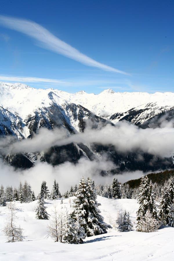 Ski lift in the mountains. Ski lift at the peaks of mountains royalty free stock photos