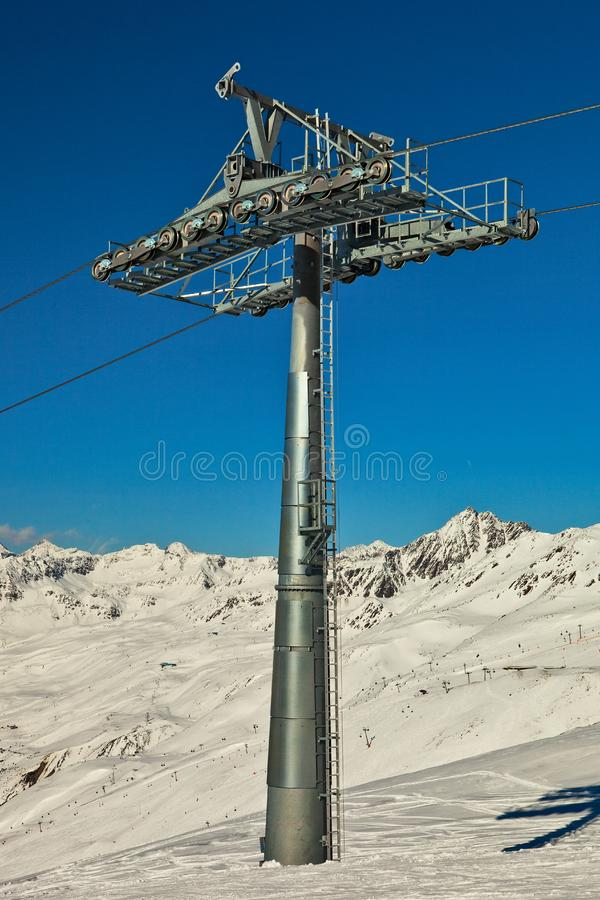 Ski lift pole with support rolls.
