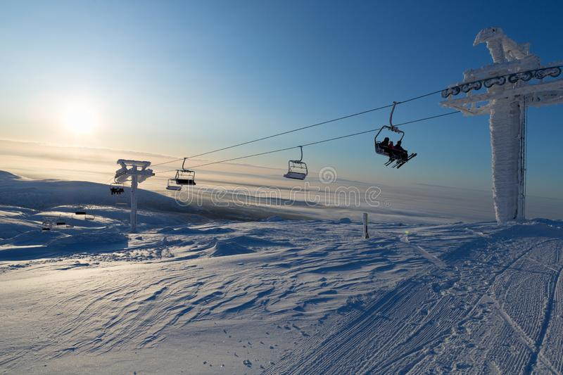 Ski lift in the rays of the sun. Khibini royalty free stock photos