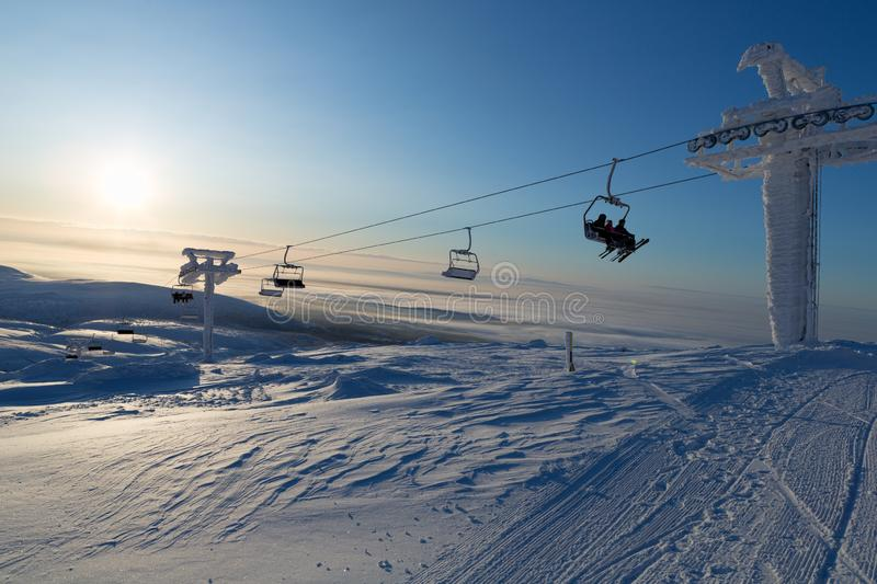 Ski lift in the rays of the sun. Sport stock image