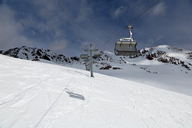 Ski lift on a ski resort. On a cloudy day stock photos