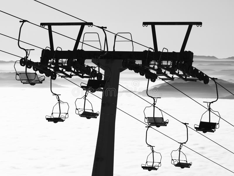 Ski lift. Silhouette ski lift over mountain royalty free stock photo