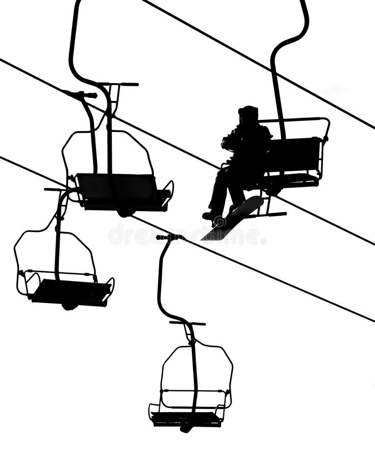 Ski lift. Silhouette ski lift over mountain stock photography