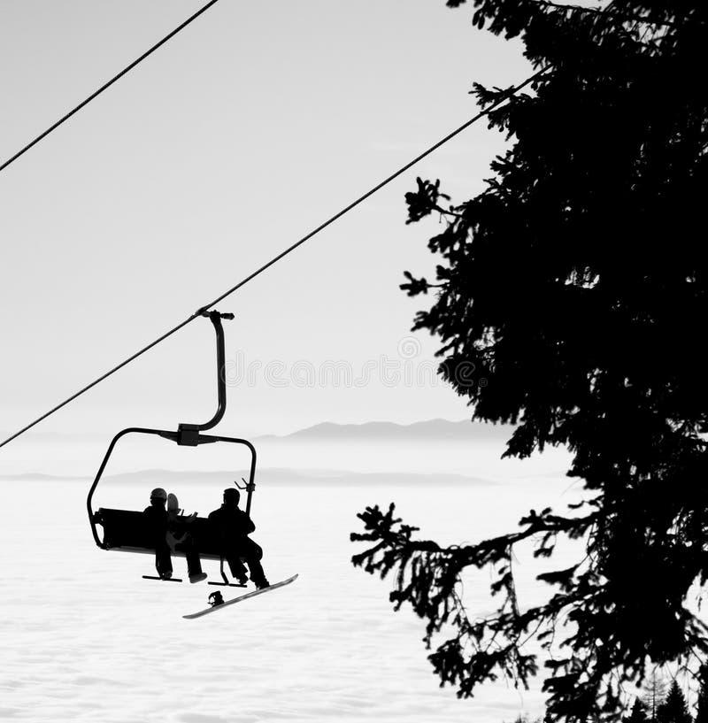 Ski lift. Silhouette ski lift over mountain stock photography