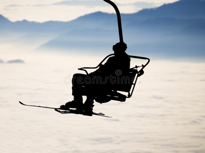 Ski lift. Silhouette ski lift over mountain royalty free stock photo