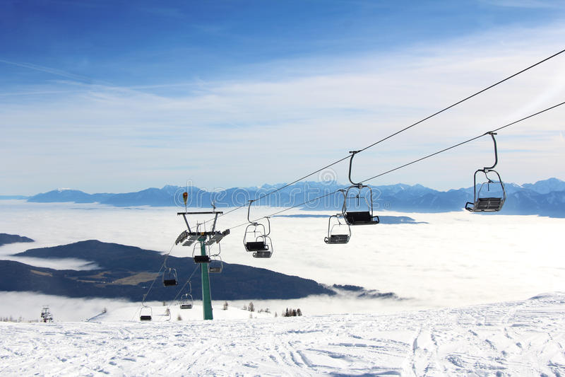 Ski lift and skiers. On the Mountain ski resort Gerlitzen, Austria stock images