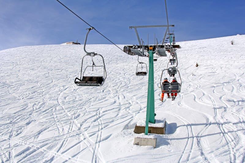 Ski lift and skiers. On the Mountain ski resort Gerlitzen, Austria royalty free stock image