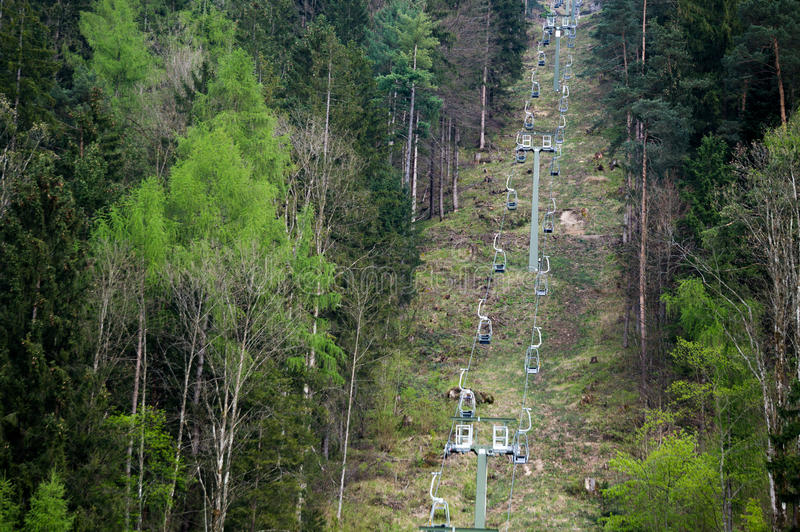 Ski lift. Sky lift cutting through an alpine forest stock images