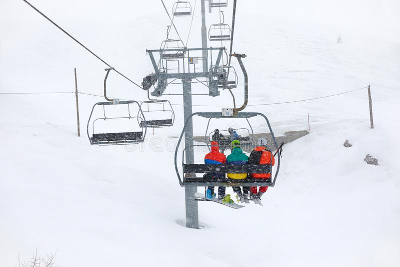 Ski lift in snow storm. Ski lift in falling snow royalty free stock photography
