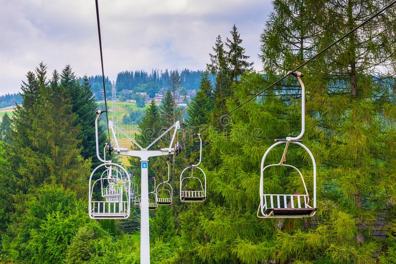 Ski lifts climb the hill royalty free stock images